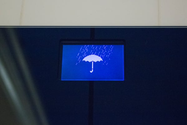 The scale displaying a screen saying it will rain