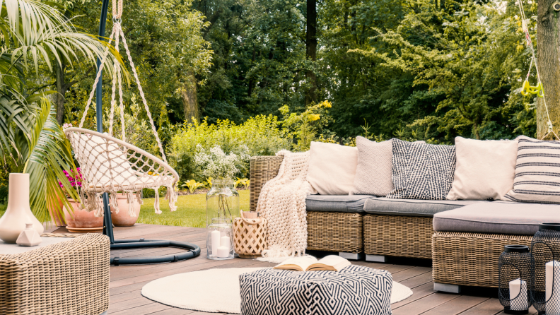 Stylish patio with cozy accents like blankets and pillows