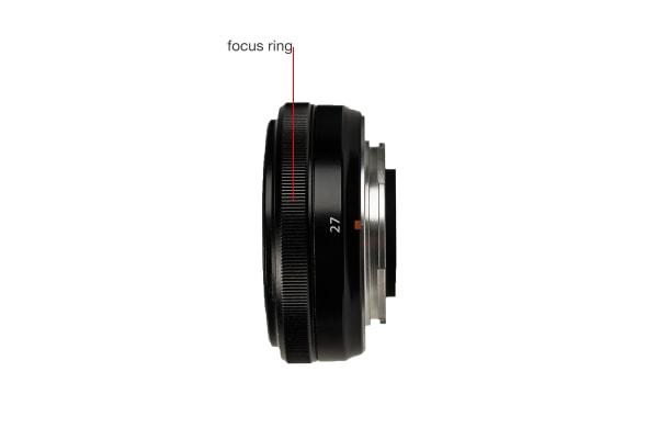 A side view of the Fujifilm Fujinon XF 27mm f/2.8.