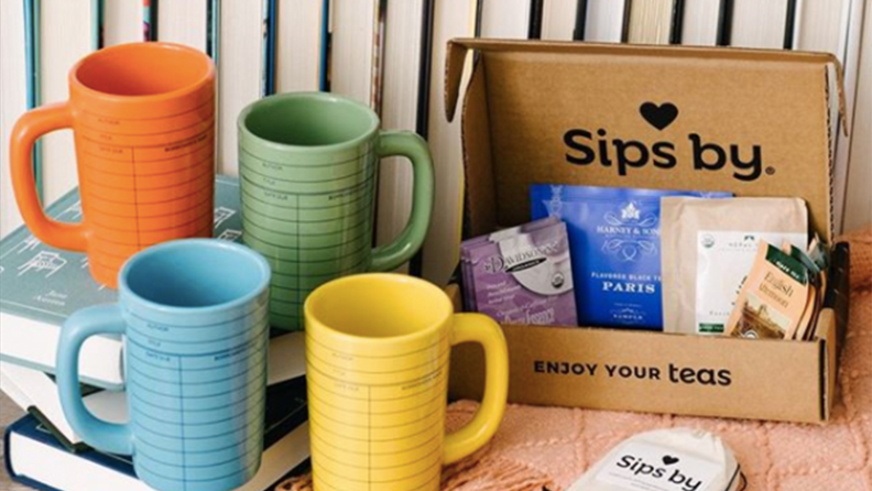 A box of tea and mugs