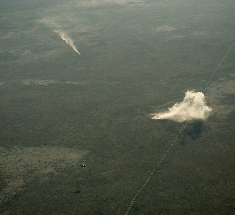 Ground Personnel Race to Soyuz Landing Site.jpg