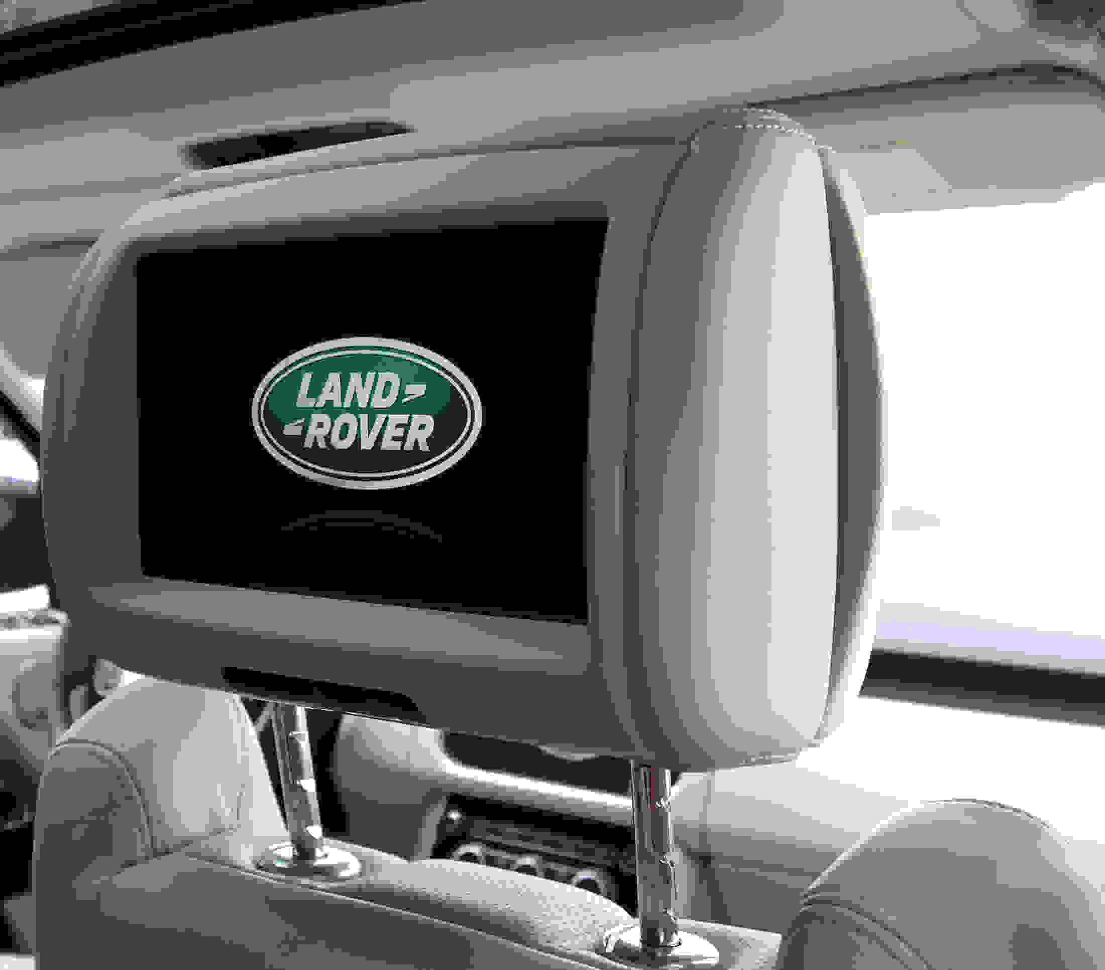 Rear seat headrest entertainment.
