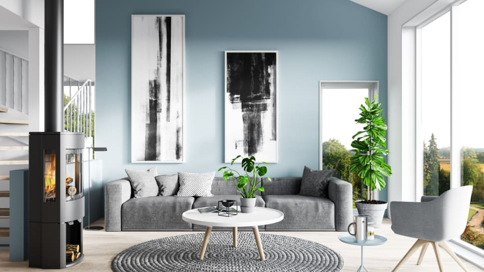 A modern living room with a light blue accent wall.