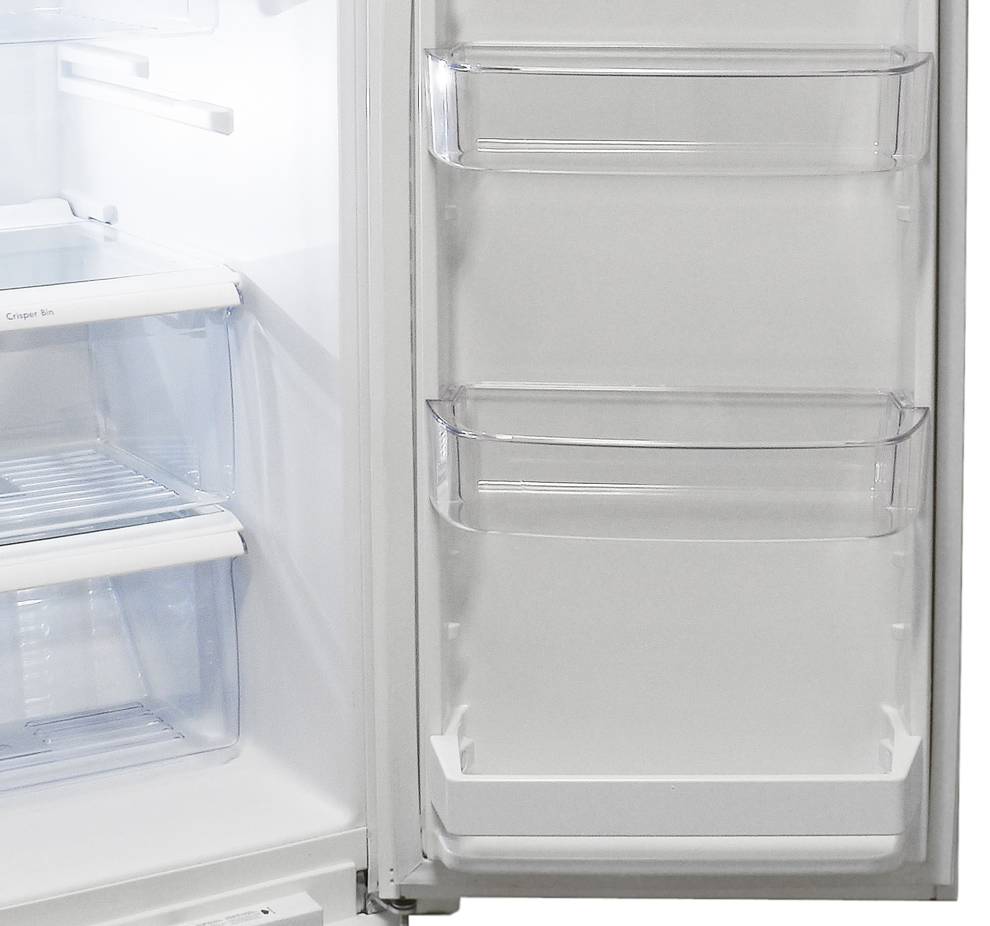 A fixed shelf at the bottom of the Kenmore 51122's fridge door balances out the dairy bin up top.