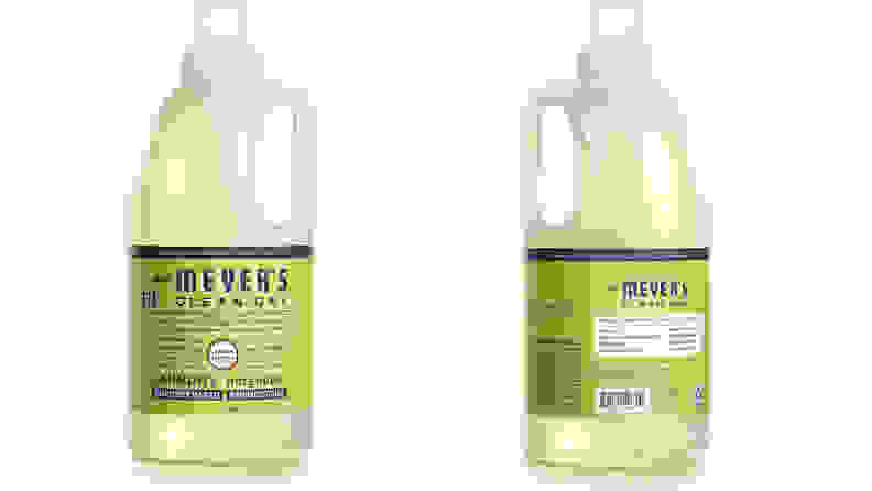 A bottle of Mrs. Meyer's laundry detergent shown from the front and the back on a white background.