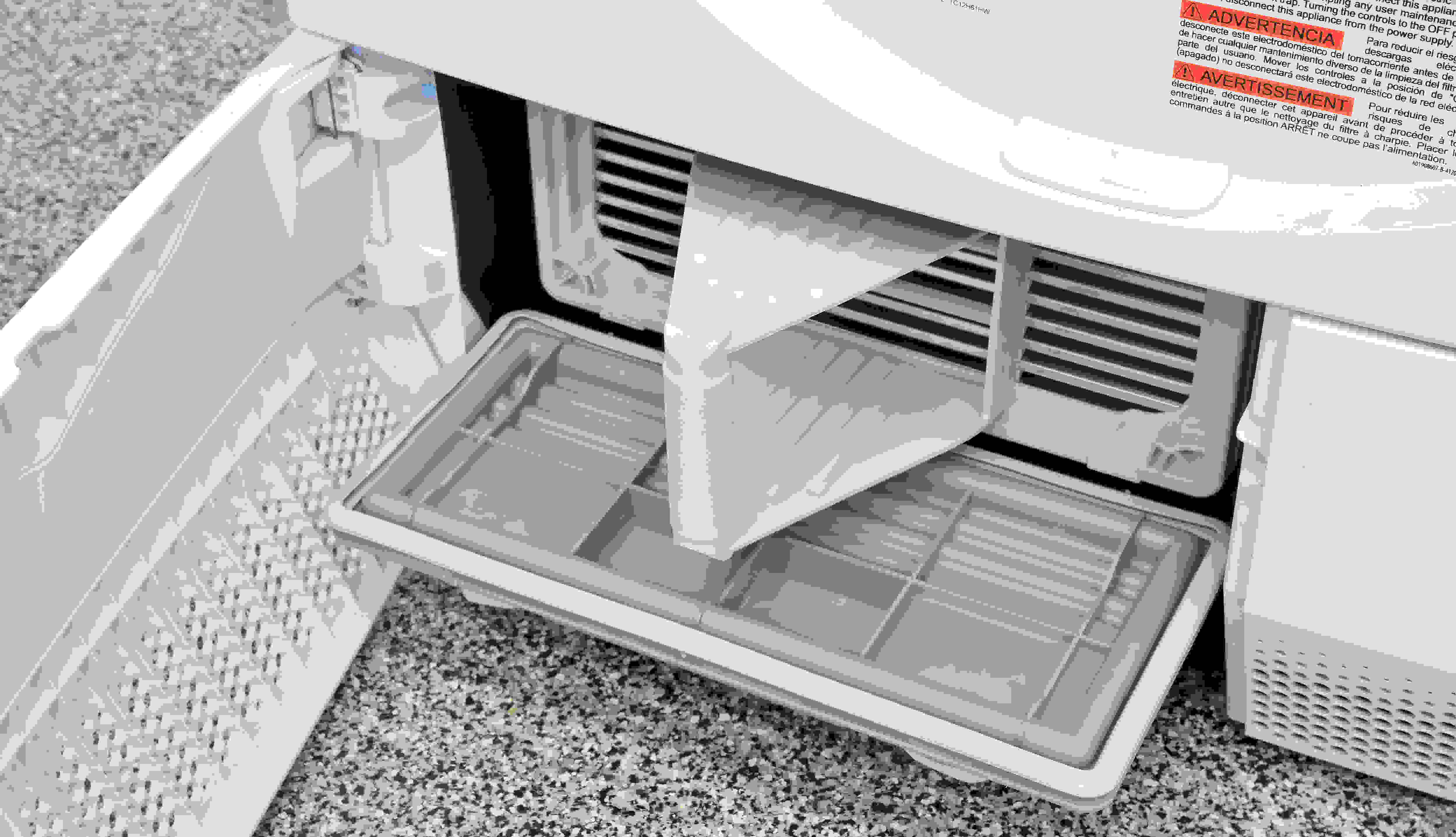 Once the secured panel has been released, pull the Electrolux EIED200QSW's condenser out by its handle.