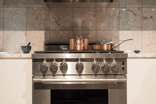A matching range hood completes the professional look