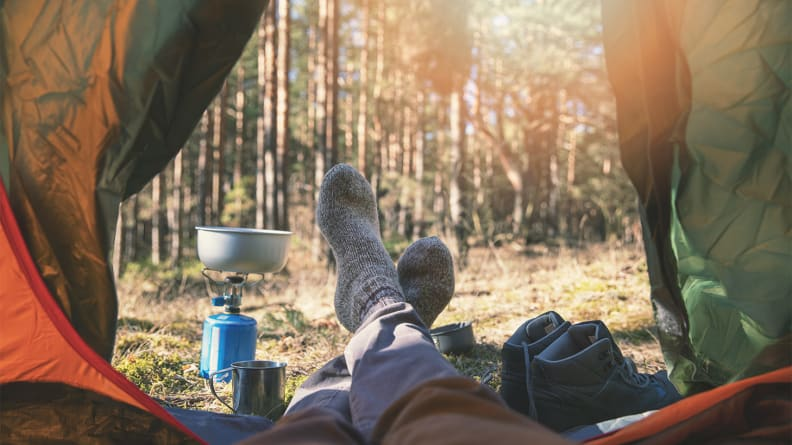 An image of someone hanging their feet out of their tent.