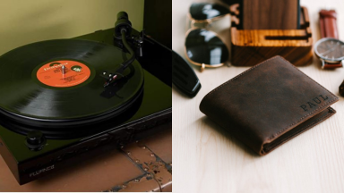 Record player displayed on table and brown leather wallet sitting amongst personal items.