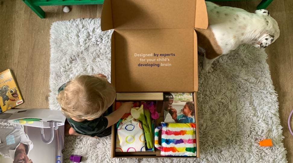 A child opens a box of Lovevery toys