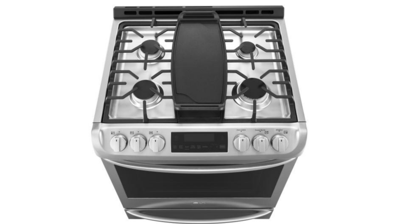 A top-down look at the LG lssg3017st gas range cooktop, which includes four standard burners, and a center oval-shaped burner covered by a cast-iron griddle(not included).
