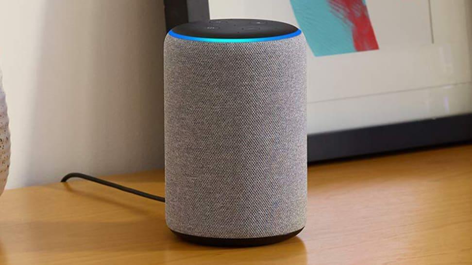 Amazon Echo Plus smart speaker actively listening with blue indicator light illuminated