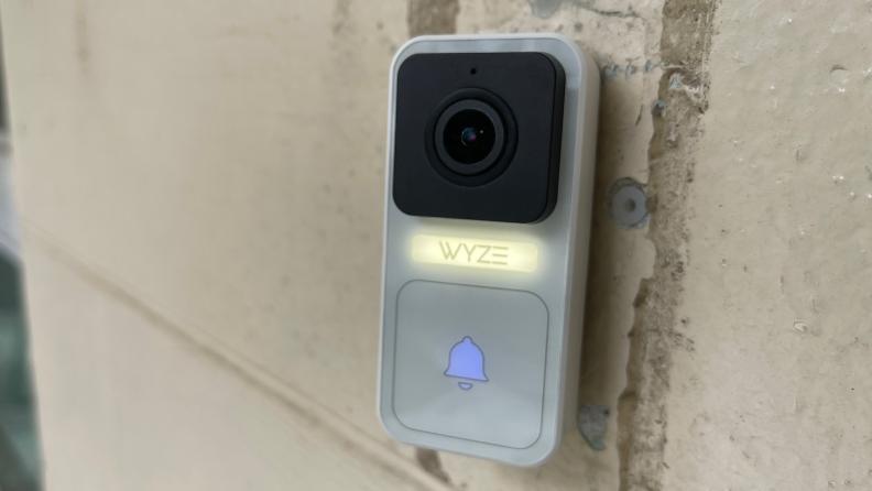 The Wyze Video Doorbell hanging near a front door.