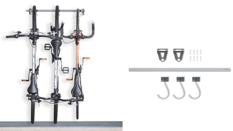 Mounted bike rack with three hooks holding bikes.