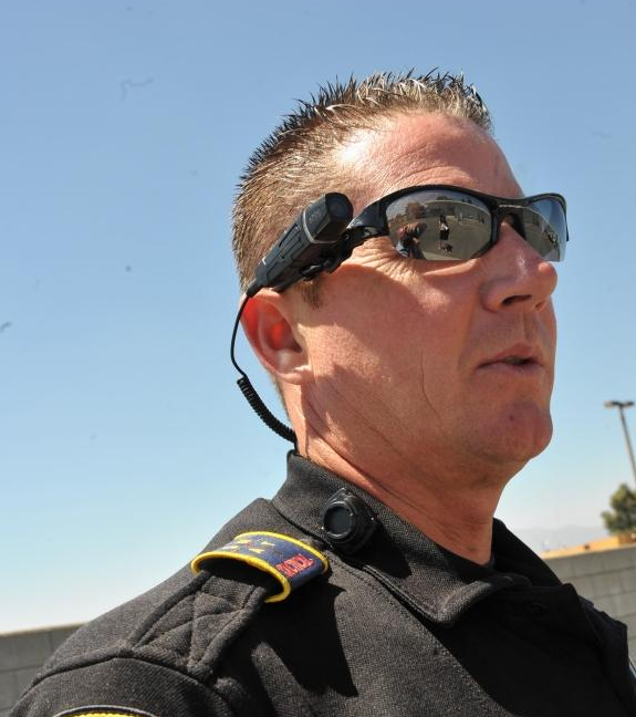 Rialto, California Sgt. Chris Hice demonstrates Taser's wearable cameras for police officers.