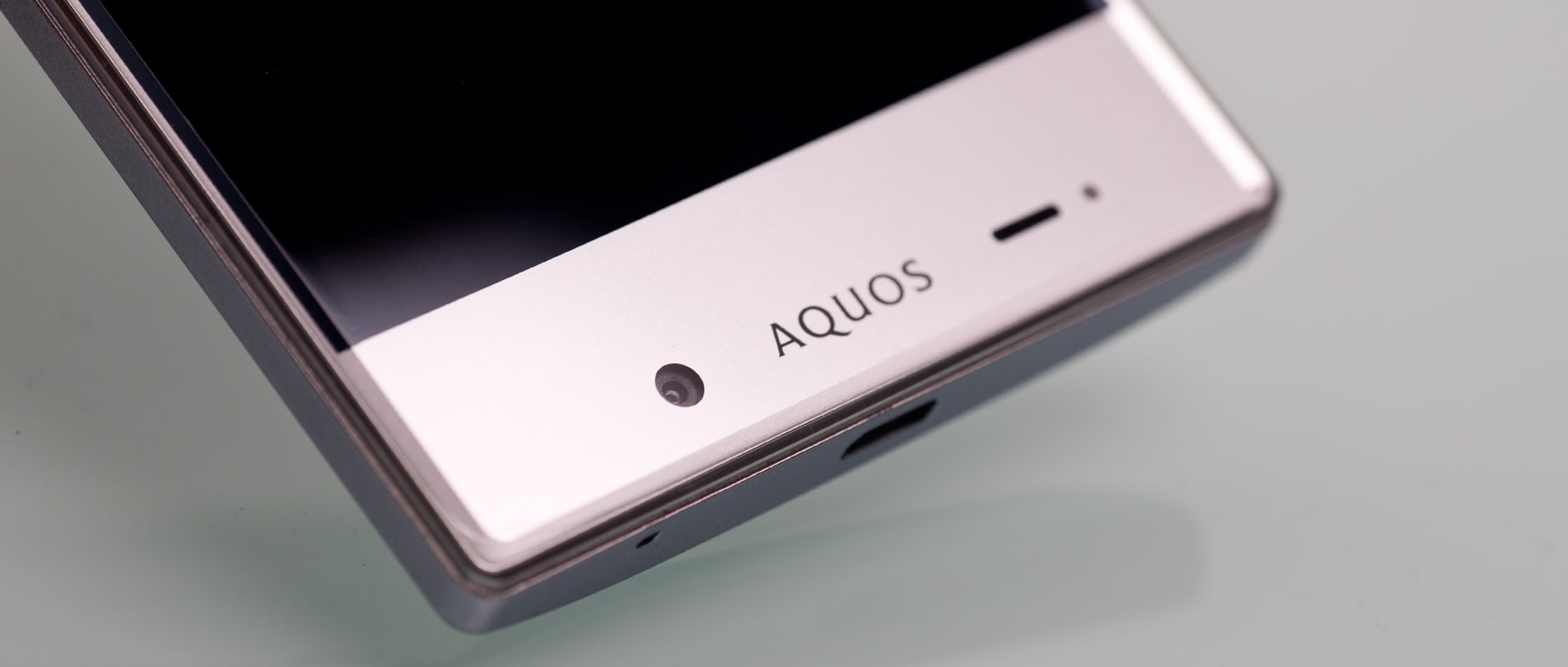 A photo of the bottom of the front of the Sharp Aquos Crystal.