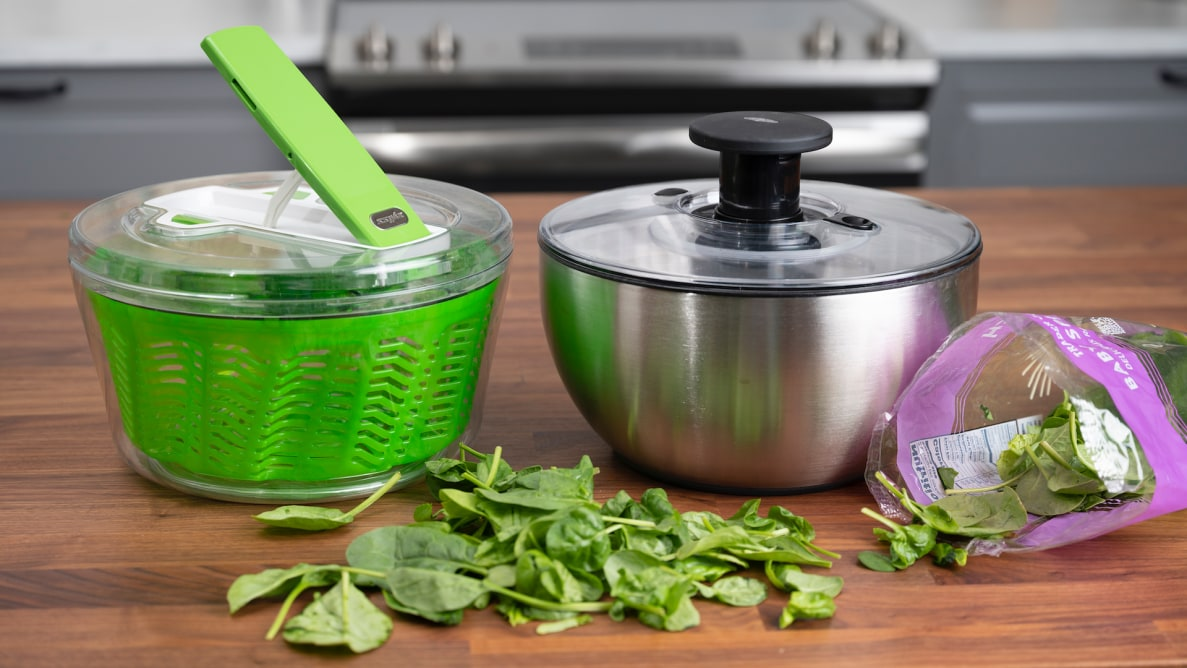 The Zyliss Dry and OXO Steel salad spinners sit side by side on a kitchen counter.