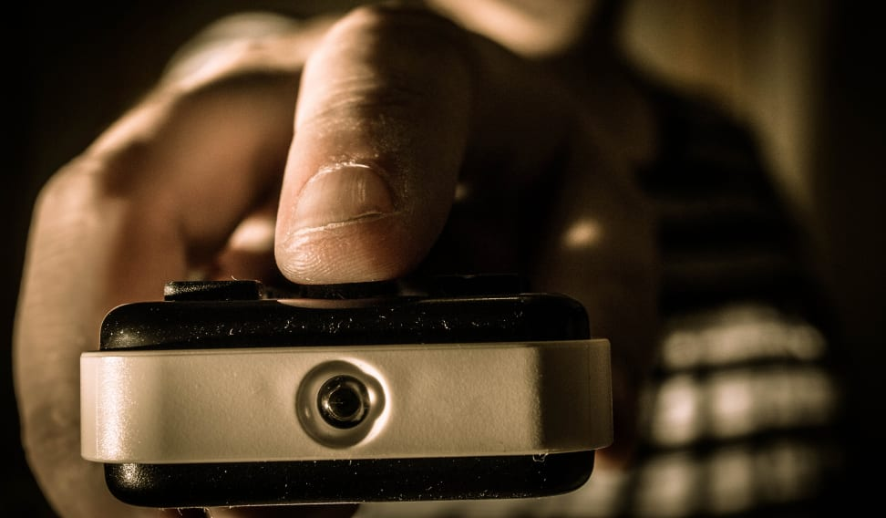 A man using a remote control