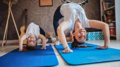 Boy and girl doing yoga at home