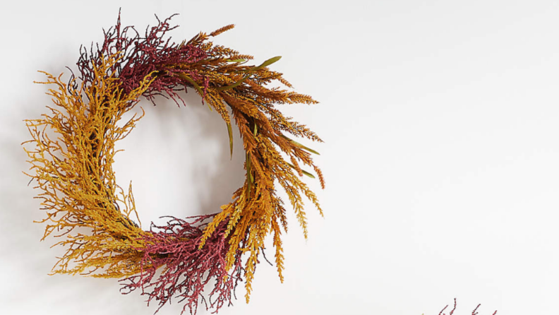 A harvest wreath on a white backdrop