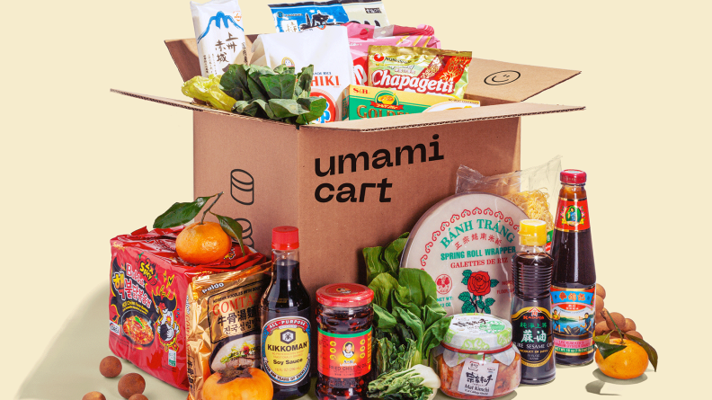 A box of Umamicart delivery can include a variety of Asian condiments, snacks, and fresh produce.
