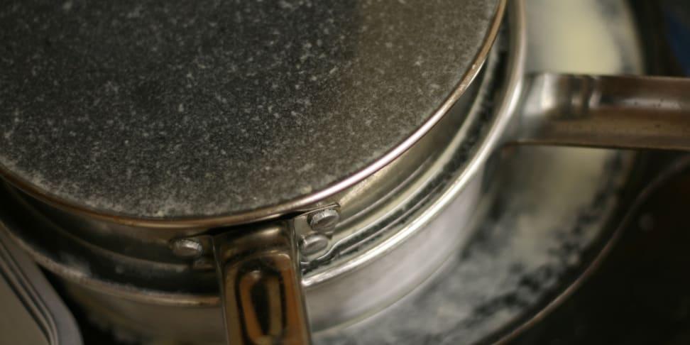 Stainless steel pots in sink