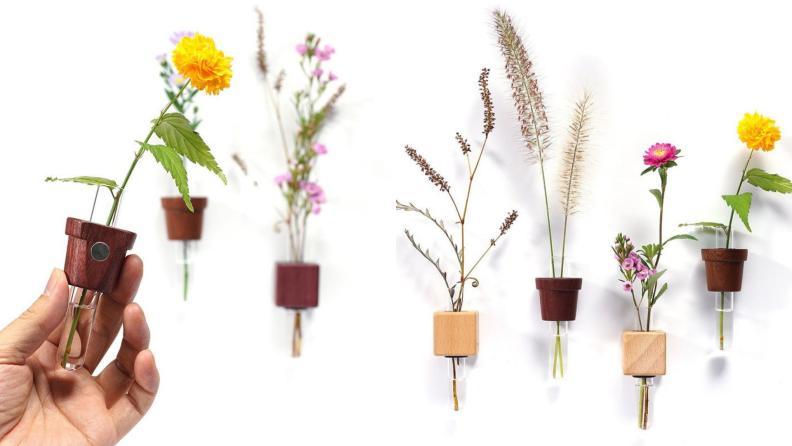 On left hand holding mini bud vase and diffuser. On right, assorted mini bud vases and diffusers.