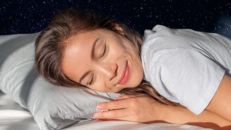 A person sleeps on a Beckham pillow.