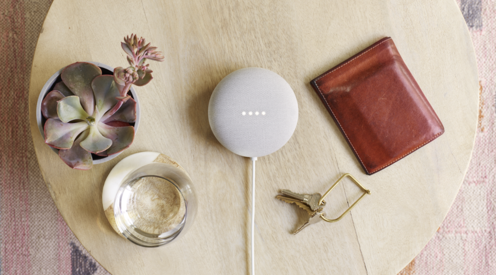 Google's Nest Mini sits on a table.
