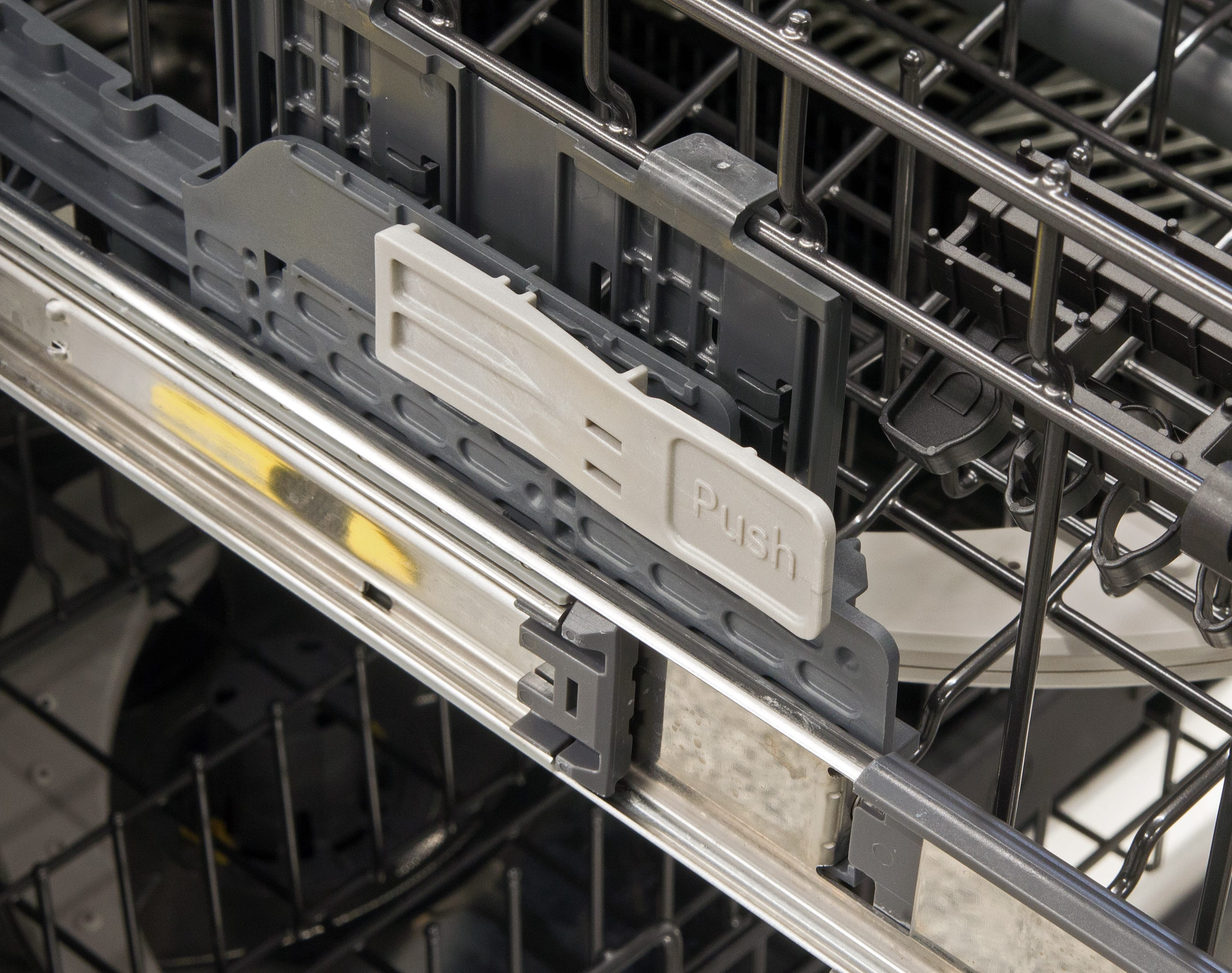 The height of the upper rack can be adjusted using the paddles on either side.