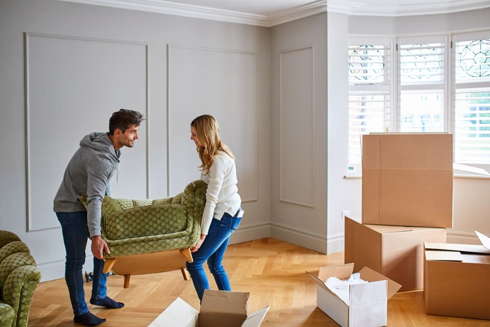 Two people moving in and renovating their home.