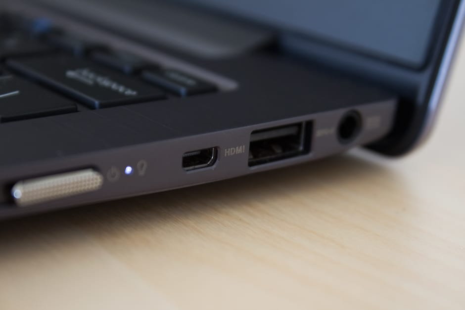 The power switch is located on the right, as well as a mini-HDMI port, USB slot, and power input.