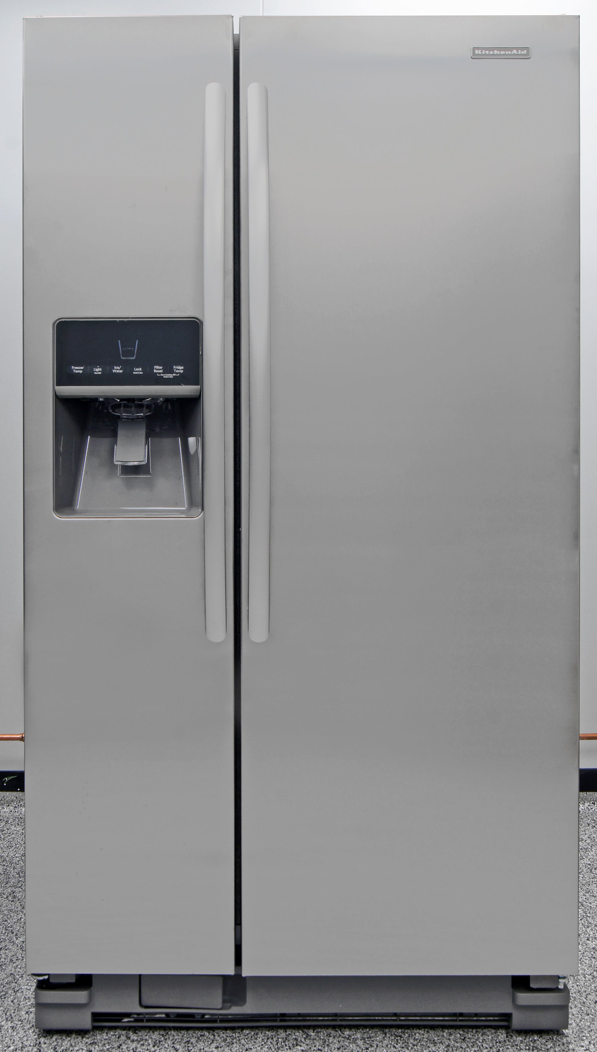 The KitchenAid KSF22C4CYY has the design and layout of a stainless side-by-side with the height of a standard top freezer combined all in one machine.