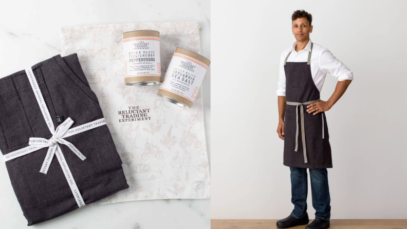 On left, black apron folded up with bow on top next to salt and pepper cans from The Reluctant Trading Company. On left, model wearing black apron from The Reluctant Trading Company.