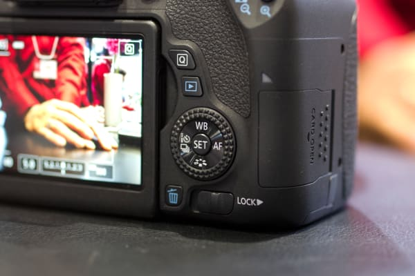 This rear control wheel splits the difference between the Rebel cameras and the higher-end EOS D series.