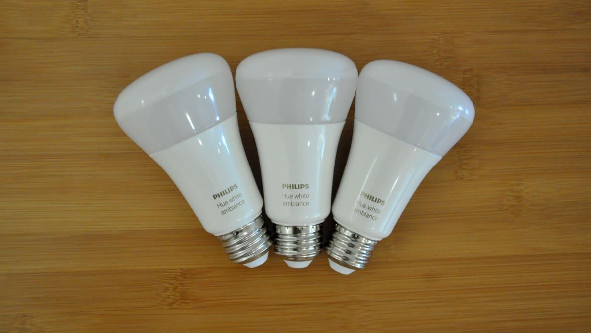 Three Philips Hue bulbs on table
