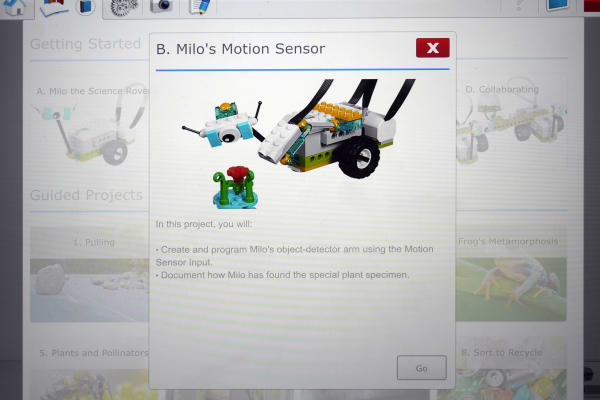 LEGO WeDo 2.0 guided lesson showing a toy's motion sensor
