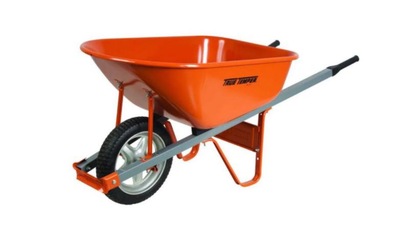 Fully assembled orange wheelbarrow.