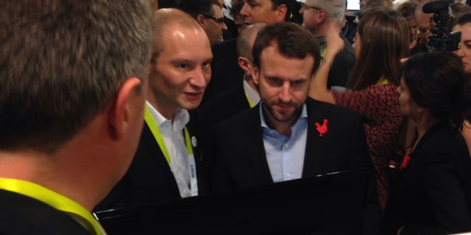 French Minister of Economy, Industry and Digital Affairs Emmanuel Macron, right, visits with French Startups Thursday at CES.