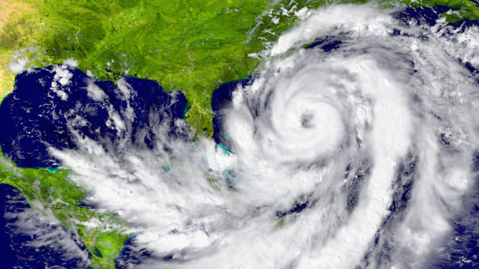 A satellite image of a hurricane swirling between Florida and Cuba