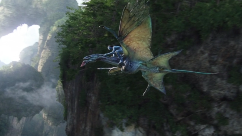 A still from 'Avatar' featuring Jake's Na'vi form on a dragon-like creature.