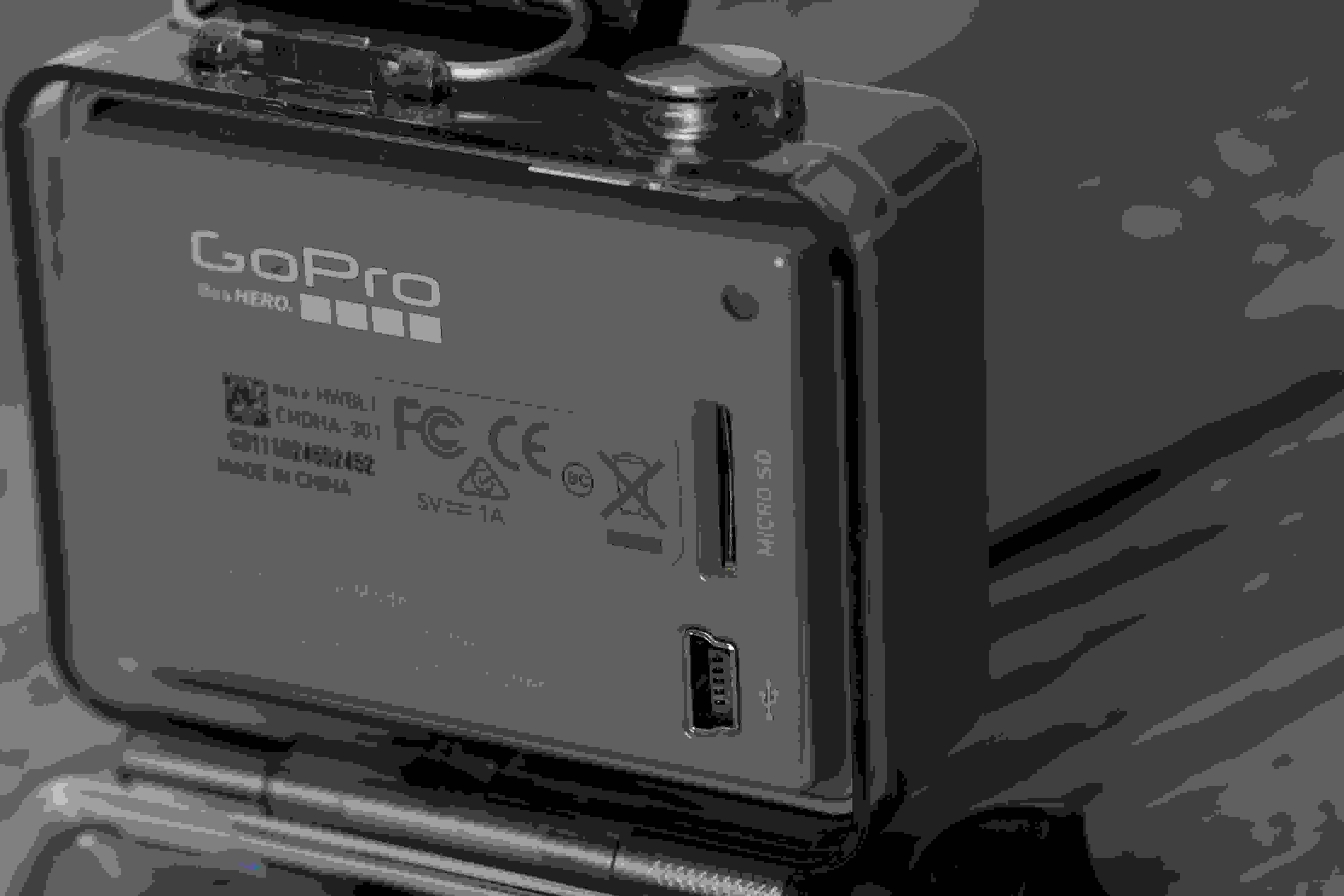 A photograph of the GoPro Hero 2014 edition's miniUSB port and microSD card slot.