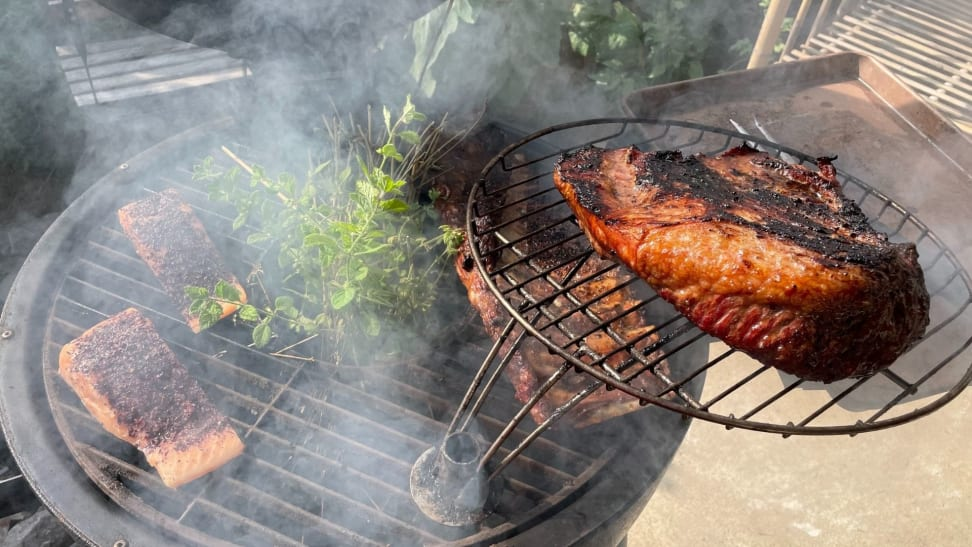 Meat smoking on a grill.