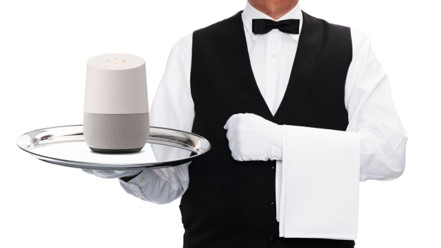 Butler with Google Home on a silver platter