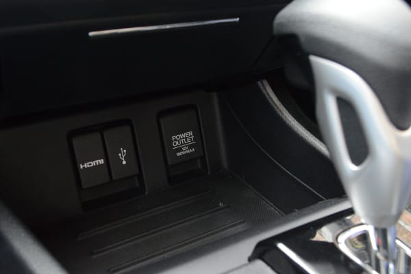 For Display Audio on the 2014 Honda Civic, here's where you plug in the two cords that emerge from your iPhone 5s, 5c, or 5.