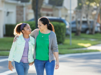 Mother and daughter walking and talking