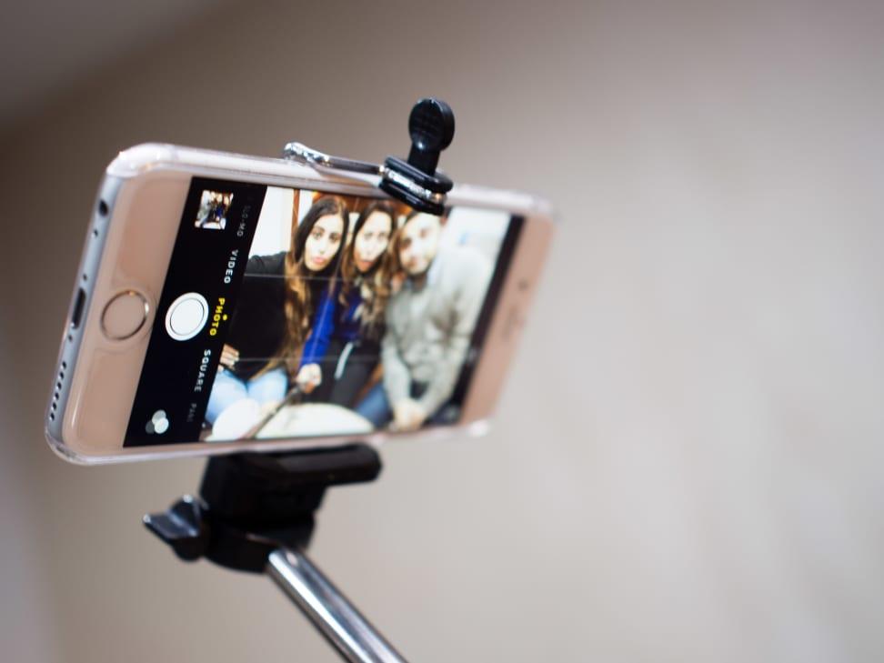 Selfie stick holding an iPhone
