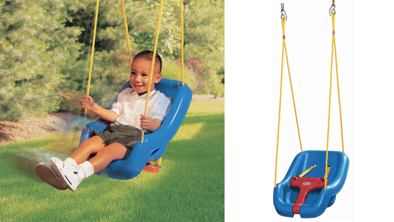 A toddler in a plastic swing