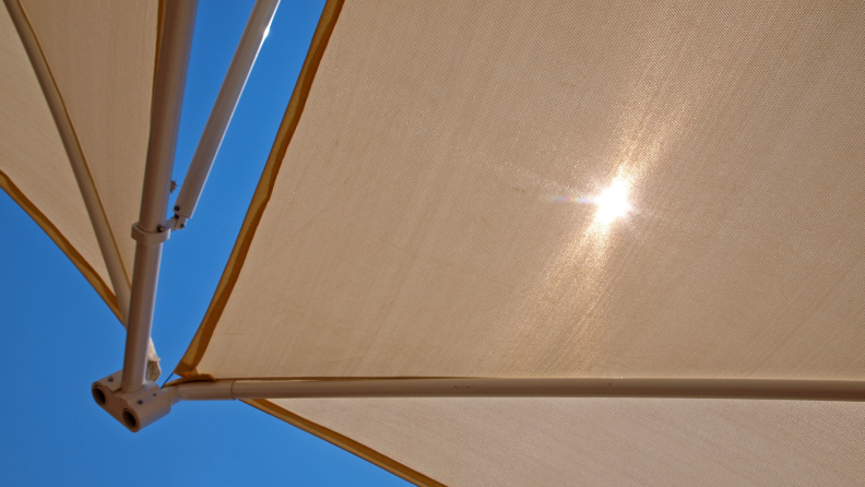 Tan solar shades block out the sun