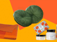 Several fall items including a russet throw blanket, olive pillows, and pumpkin soaps on an orange and yellow backdrop.